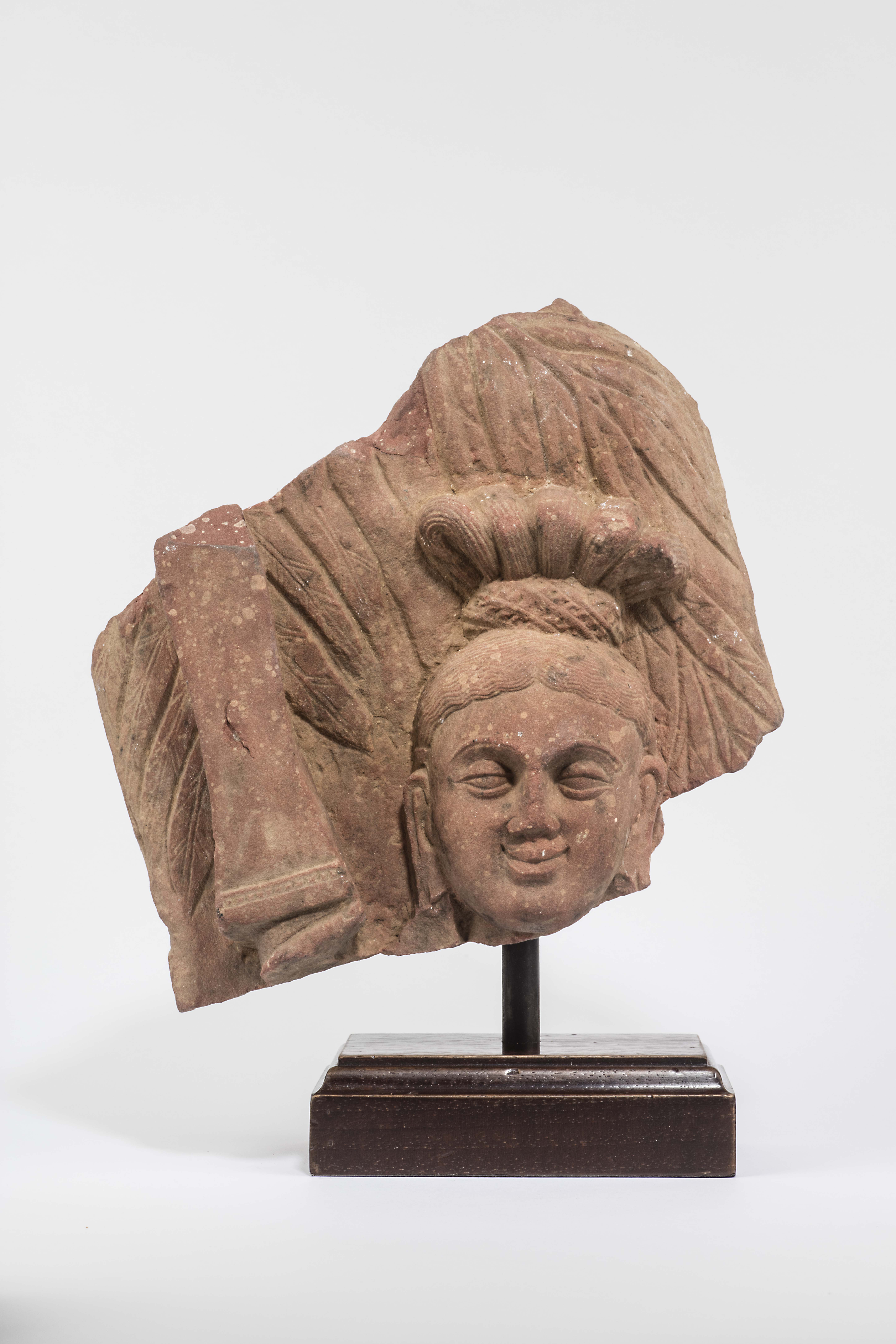 A Red Sikri Sandstone Fragment of Yakshi with Raised Sword