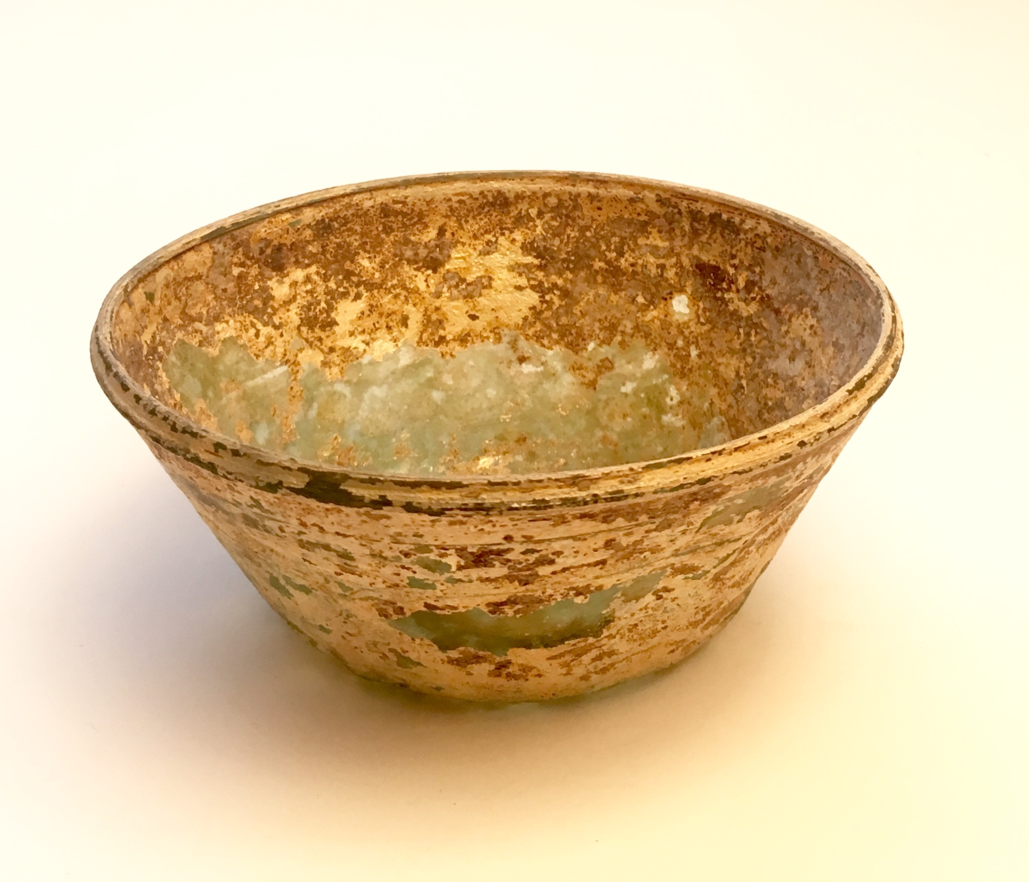 A GREENISH GLASS CONICAL BOWL